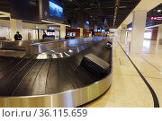 """""""Schoenefeld, Germany, Emptiness at the baggage claim in times of the Corona crisis in the terminal of the airport BER"""" Редакционное фото, агентство Caro Photoagency / Фотобанк Лори"""