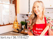 Woman in the kitchen with baking ingredients, and holding a rolling... Стоковое фото, фотограф Zoonar.com/Leah-Anne Thompson / easy Fotostock / Фотобанк Лори