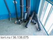 old polyethylene sewer pipes are in the entrance after major repairs. Стоковое фото, фотограф Акиньшин Владимир / Фотобанк Лори