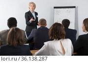 Senior woman giving speech in meeting room. Стоковое фото, фотограф Яков Филимонов / Фотобанк Лори