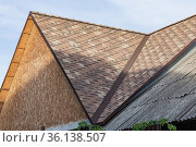Repair, construction and building materials, wooden roof of the building covered with soft flexible tiles and slate. Стоковое фото, фотограф Светлана Евграфова / Фотобанк Лори