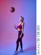 Young sexy sportswoman with ball poses in studio. Стоковое фото, фотограф Tryapitsyn Sergiy / Фотобанк Лори