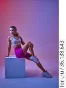 Sexy sportswoman poses at the cube in studio. Стоковое фото, фотограф Tryapitsyn Sergiy / Фотобанк Лори