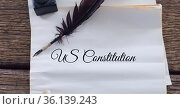 Composition of text us constitution, with quill pen and inkwell on antique documents. Стоковое фото, агентство Wavebreak Media / Фотобанк Лори