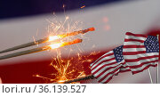 Composition of lit sparklers with american flags. Стоковое фото, агентство Wavebreak Media / Фотобанк Лори