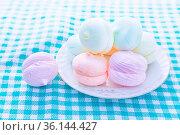 Close-up photo of zephyrs on the white dish served on table. Стоковое фото, фотограф Zoonar.com/Svetlana Radayeva / easy Fotostock / Фотобанк Лори
