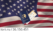 Composition of passport and air travel ticket on american flag. Стоковое фото, агентство Wavebreak Media / Фотобанк Лори