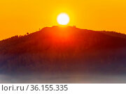 Magnificent sunrise over Mount Eseikey in the Ural Mountains, the beginning of an autumn day. Стоковое фото, фотограф Акиньшин Владимир / Фотобанк Лори