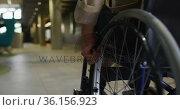 Disabled african american businessman in wheelchair in office corridor. Стоковое видео, агентство Wavebreak Media / Фотобанк Лори
