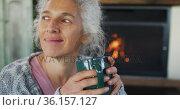 Senior mixed race woman holding mug and smiling. Стоковое видео, агентство Wavebreak Media / Фотобанк Лори