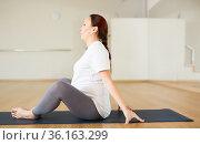 Pregnant woman is engaged in yoga. Butterfly Pose or Baddha Konasana. Стоковое фото, фотограф Татьяна Яцевич / Фотобанк Лори