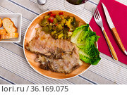 Juicy roast pork on a plate with stewed vegetables. Стоковое фото, фотограф Яков Филимонов / Фотобанк Лори