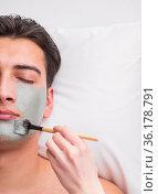Handsome man in spa massage concept. Стоковое фото, фотограф Elnur / Фотобанк Лори