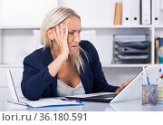 Worried female manager in office. Стоковое фото, фотограф Яков Филимонов / Фотобанк Лори