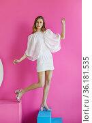 Pleasing young woman on pink background. Стоковое фото, фотограф Алексей Кузнецов / Фотобанк Лори