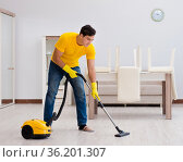 Man husband cleaning the house helping his wife. Стоковое фото, фотограф Elnur / Фотобанк Лори