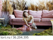 Fantasy concept with a young adult woman releasing a boat on the water. Стоковое фото, фотограф Алексей Кузнецов / Фотобанк Лори