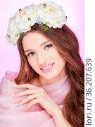 Beautiful young woman with long hair and natural pink makeup. Flower... Стоковое фото, фотограф Zoonar.com/Svetlana Mandrikova (@Svetography) / easy Fotostock / Фотобанк Лори