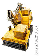 Rusted yellow toy crane isolated against white background. Стоковое фото, фотограф Zoonar.com/Yann Poirier / easy Fotostock / Фотобанк Лори