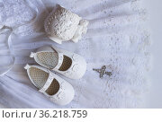 Christening baby shoes, christening cup and crystal cross pendant... Стоковое фото, фотограф Zoonar.com/Tosca M White / easy Fotostock / Фотобанк Лори