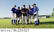 Group portrait of diverse team of female baseball players and coach standing on sunny pitch smiling. Стоковое видео, агентство Wavebreak Media / Фотобанк Лори