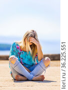 Alone under the sun adolescent teen girl sad looking down. Стоковое фото, фотограф Emil Pozar / age Fotostock / Фотобанк Лори