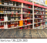 Vintage wooden boards with view to shelves of supermarket. Table top... Стоковое фото, фотограф Zoonar.com/Alexmak7 / easy Fotostock / Фотобанк Лори