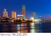 Night view of the skyscrapers of the city of Yekaterinburg. Russia. Reflection in the river (2019 год). Стоковое фото, фотограф Евгений Ткачёв / Фотобанк Лори
