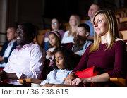 European woman with preteen mulatto girl and aframerican man in cinema. Стоковое фото, фотограф Яков Филимонов / Фотобанк Лори