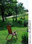 Gartenstuhl zur Erholung im Garten - Garden chair for recreation in... Стоковое фото, фотограф Zoonar.com/lantapix / easy Fotostock / Фотобанк Лори