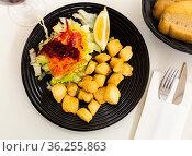 Pieces of fried cuttlefish breaded with vegetables. Стоковое фото, фотограф Яков Филимонов / Фотобанк Лори