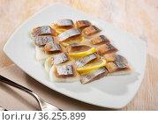 Fillet herring with rosemary, onion and lemon. Стоковое фото, фотограф Яков Филимонов / Фотобанк Лори
