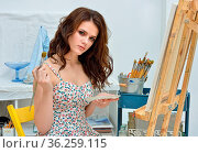Art school, creativity, woman with easel, palette and brush painting... Стоковое фото, фотограф Zoonar.com/© Dmitry Raikin / easy Fotostock / Фотобанк Лори