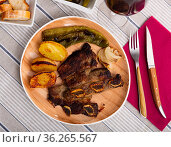 Tasty beef baked with potatoes and stewed peppers served. Стоковое фото, фотограф Яков Филимонов / Фотобанк Лори