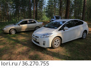 Cars in a clearing in a pine forest. Стоковое фото, фотограф Юрий Бизгаймер / Фотобанк Лори