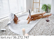 Sexy young woman reads a magazine in a bubble bath. Стоковое фото, фотограф Tryapitsyn Sergiy / Фотобанк Лори