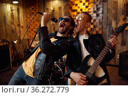 Two musicians at microphone, rock band. Стоковое фото, фотограф Tryapitsyn Sergiy / Фотобанк Лори