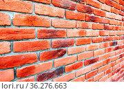 Old weathered red brick wall as background. Bricks masonry with seams... Стоковое фото, фотограф Zoonar.com/Alexander Blinov / easy Fotostock / Фотобанк Лори