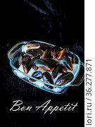Very tasty and fresh mussels on ice cubes-the inscription of a Bon... Стоковое фото, фотограф Zoonar.com/Sergiy Artsaba / easy Fotostock / Фотобанк Лори