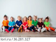 Group of cheerful preschool children in colorful sportswear sitting... Стоковое фото, фотограф Zoonar.com/OKSANA SHUFRYCH / easy Fotostock / Фотобанк Лори