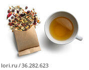 Green tea with natural aromatic additives and a Cup of tea. Top view... Стоковое фото, фотограф Zoonar.com/Aleksey Butenkov / easy Fotostock / Фотобанк Лори