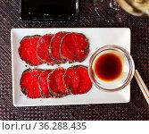 Slices of raw beef with sauce. Стоковое фото, фотограф Яков Филимонов / Фотобанк Лори