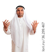 A happy arab middle eastern man with hands outstretched in praise... Стоковое фото, фотограф Zoonar.com/Leah-Anne Thompson / easy Fotostock / Фотобанк Лори