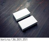 Blank business cards on wood table background. Mockup for branding... Стоковое фото, фотограф Zoonar.com/Alex Veresovich / easy Fotostock / Фотобанк Лори