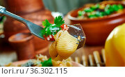 Caponata pasta - Sweet-sour eggplant caponata makes a great sauce... Стоковое фото, фотограф Zoonar.com/MYCHKO / easy Fotostock / Фотобанк Лори