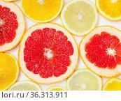 Citrus pattern of orange lemon and grapefruit slices. Different citrus... Стоковое фото, фотограф Zoonar.com/alexmak / easy Fotostock / Фотобанк Лори
