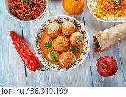 Mantu, Beef Dumplings. Afghani uisine, central Asia Traditional assorted... Стоковое фото, фотограф Zoonar.com/MYCHKO / easy Fotostock / Фотобанк Лори