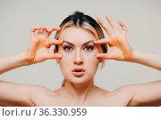 Young adult woman doing facial gymnastics self massage and rejuvenating... Стоковое фото, фотограф Zoonar.com/Max / easy Fotostock / Фотобанк Лори
