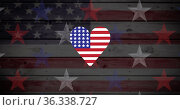 Image of heart coloured with american flag on wooden background. Стоковое фото, агентство Wavebreak Media / Фотобанк Лори