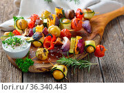 Grilled skewers with mixed vegetables served on a wooden cutting board... Стоковое фото, фотограф Zoonar.com/Karl Allgäuer / easy Fotostock / Фотобанк Лори
